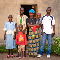From left: Anataria Kamariza; her brother, Theophile Uzayisenga; father, Muberuka Boniface; mother, Marie Murekatete; sister, Rusie Kamayirese; and older brother, Stratton Ngendahayo, at their home in Rwanda.