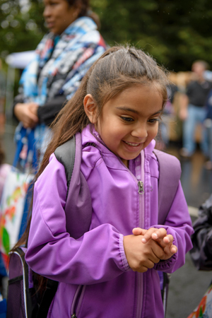 Alexia Balzamo receives a brand-new backpack filled with school supplies from World Vision.