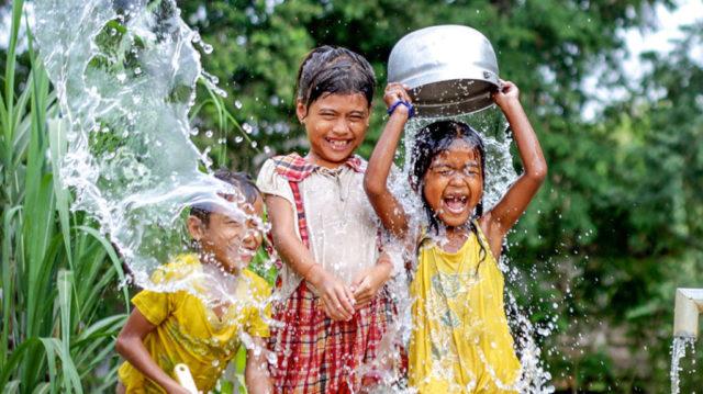 Kids enjoying clean water.