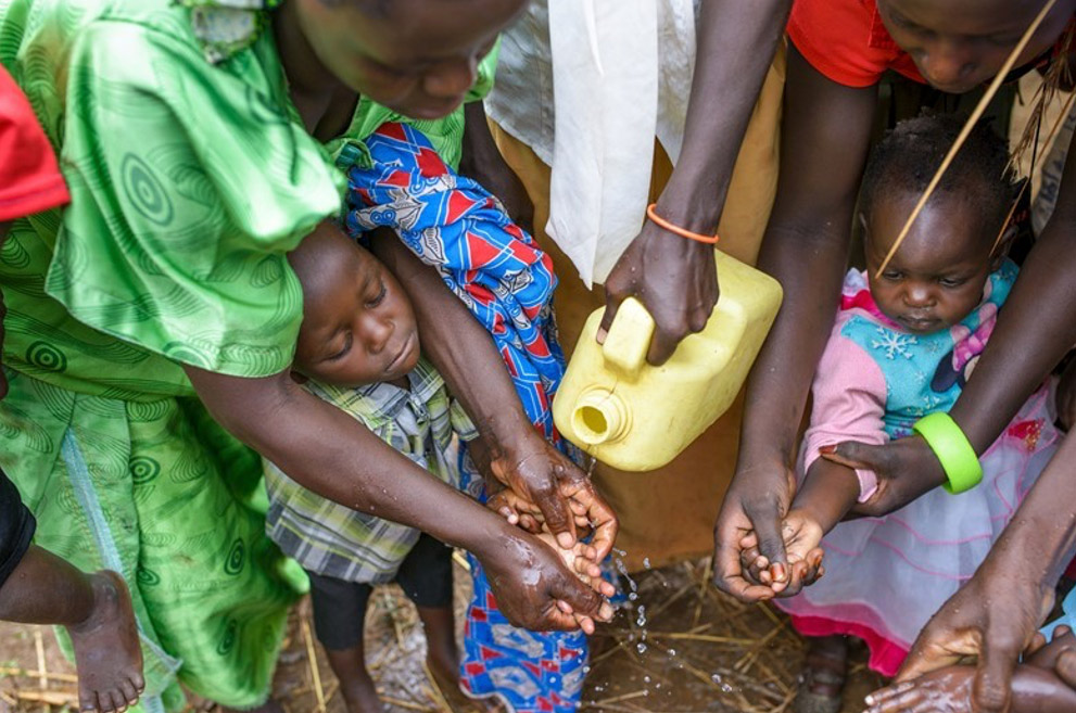 Women washing their hands