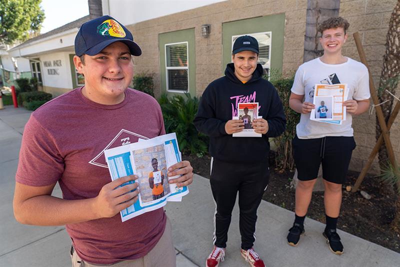Three student participating in World Vision's Chosen sponsorship partnership