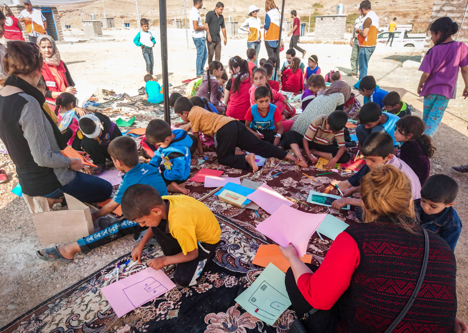 Children whose families have fled conflict in villages near Mosul, Iraq, play and draw in a World Vision Child-Friendly Space in Zelican camp. (©2016 Nick Ralph/World Vision)