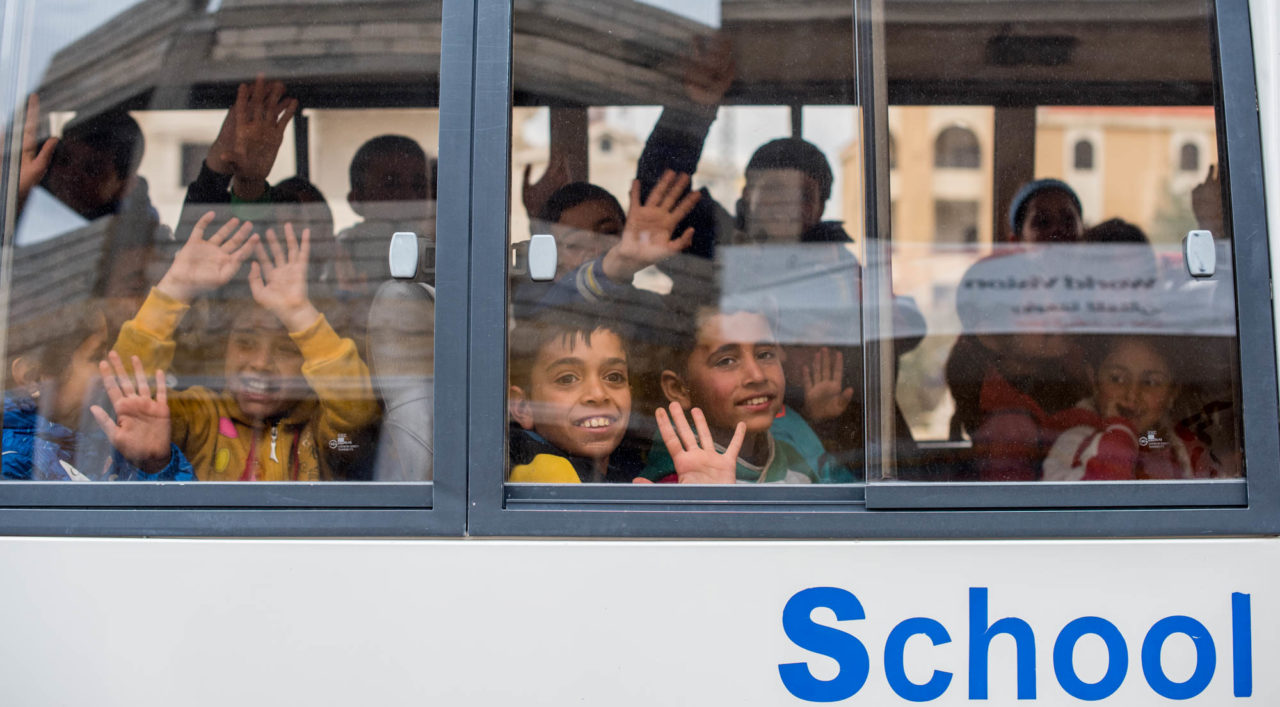 Syrian refugee children riding bus ©2016 World Vision/Jon Warren