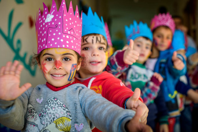 Children with paper crowns and face paint ©2016 Jon Warren | World Vision