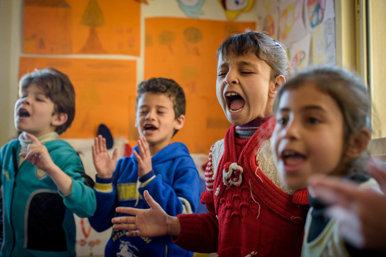 Children singing at child friendly space ©2016 Jon Warren | World Vision.