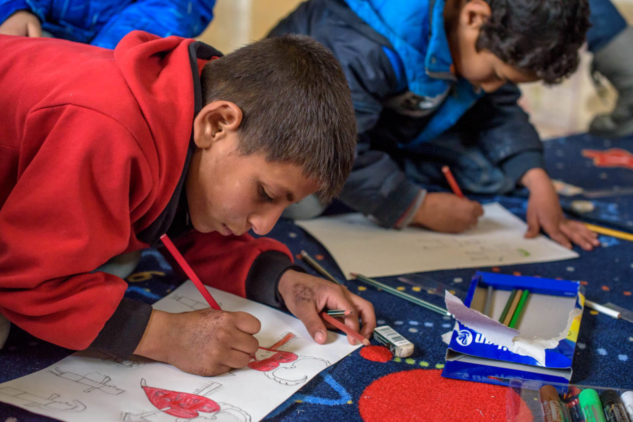 Syrian refugee children draw (©2016 World Vision/photo by Jon Warren)