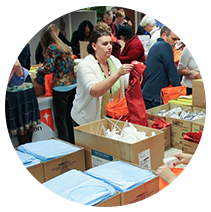 Employees sorting through boxes of donations.