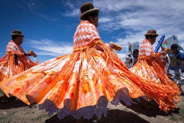 Traditional dancers swirl in Bolivia.