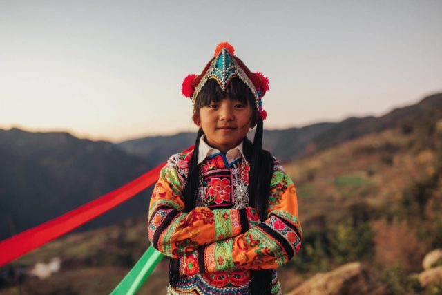Traditionally dressed girl in rural China. The red carpet at the Academy Awards is crowded with glamorous gowns and tailored tuxedos as Hollywood stars put their best foot forward. We've got our own best-dressed list: children around the world who celebrate their cultural pageantry with traditional clothing.