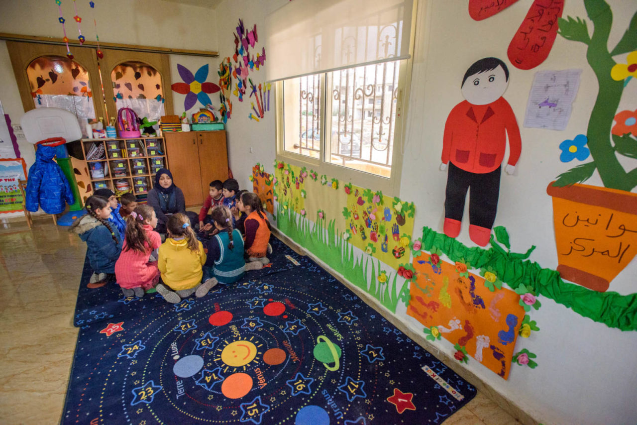 Teacher and students at a World Vision Child-Friendly Space for Syrian refugee children in Lebanon. Photo ©2016 World Vision/Jon Warren