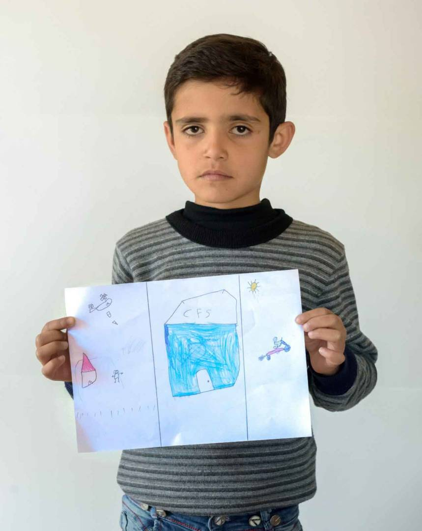 Habib shows his photo.