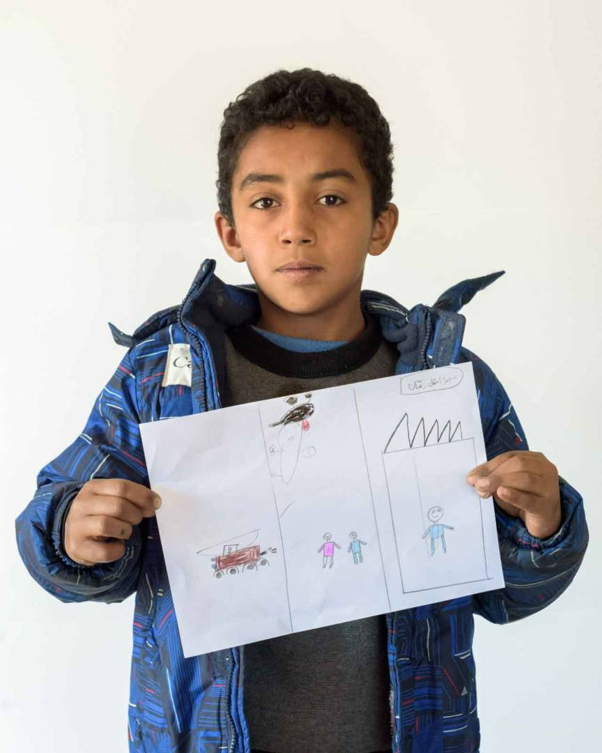 Abdul shares his drawing.