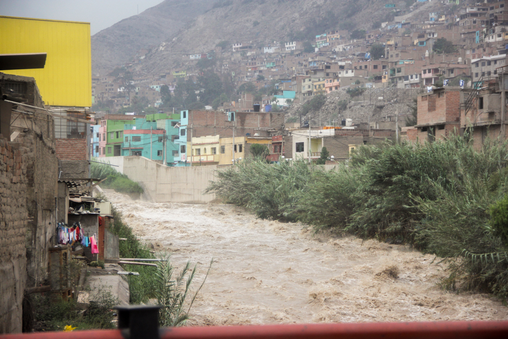 Peru's deadly floods keep getting worse. A swollen Rímac River rages through neighborhoods at the base of a mountain an hour east of Lima. Flooding and mudslides threaten people's homes after months of rain have saturated the ground around them. (©2017 World Vision/photo by Carol Atencio)