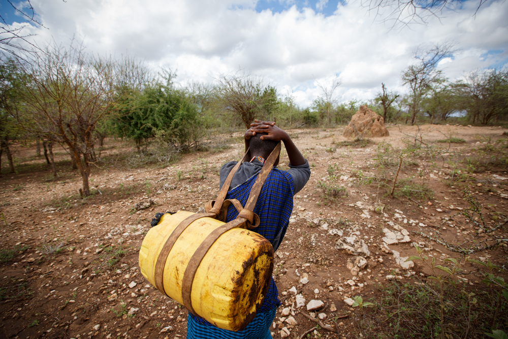Margaret Lankoi, 27, carries a 20-liter can of water near her home in rural southern Kenya. A container this large weighs about 44 pounds when full of water. (©2016 World Vision/Photo by Chris Huber)