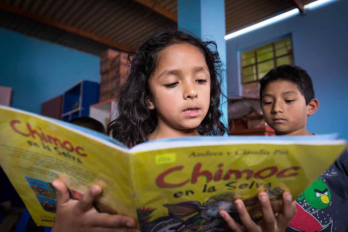 A child in Peru reads a book.