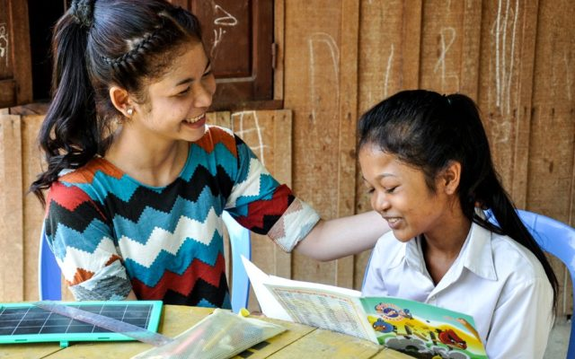 "Dira, left, encourages her 12-year-old sister, Phinat, right, in her studies. Dira is the sixth of eight children and had to leave school in the second grade so she could scavenge for junk to help her family earn money after her father died. Later, with World Vision's help, she got nonformal education and vocational training and now runs a hairdresser shop in her town of Battambang, Cambodia. Because of her experience, she wants her younger siblings to have a different life, including Phinat. ""I want them to study until [they] finish class,"" she says. ""I don't want Phinat to scavenge because she is too young. Scavengers face risk, such as rape and traffic accidents."" Phinat has the second-highest grades in her class of 30 students. ""My older sister encourages me to study hard,"" Phinat says. ""She doesn't allow me to pick up junk."""