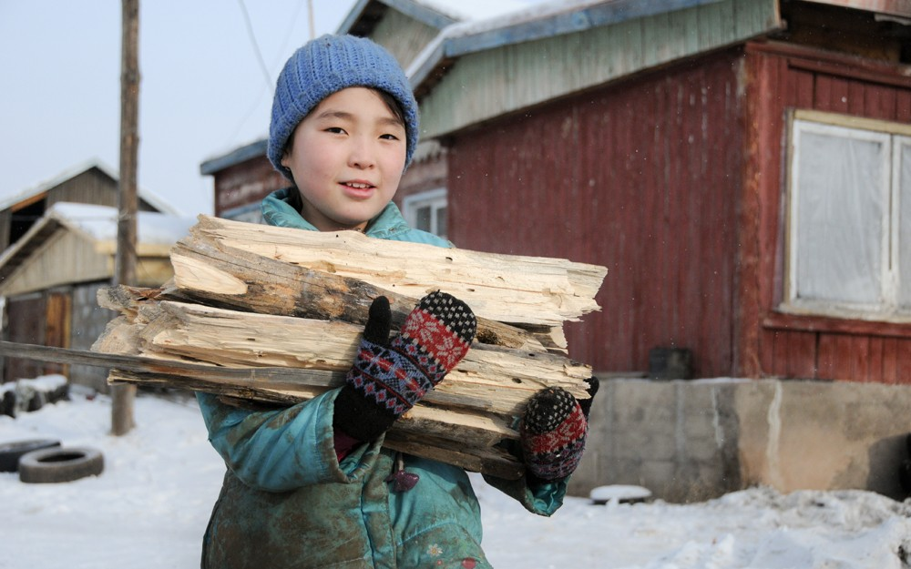 MORNING CHORES. After breakfast and before she heads to school, Anujin, 10, helps her parents around their house in Altanbulag, Mongolia, by gathering wood. Chores are only part of Anujin's day — she spends the majority of her time at school — but 17 million girls around the world will probably never attend school, according to UNESCO. Sometimes chores, like collecting water and farming, or sickness related to waterborne disease and malaria, keep kids out of the classroom. As a sponsored child, Anujin and her family have benefited from World Vision's agricultural training and water programs in Altanbulag — so Anujin is free to attend school every day.