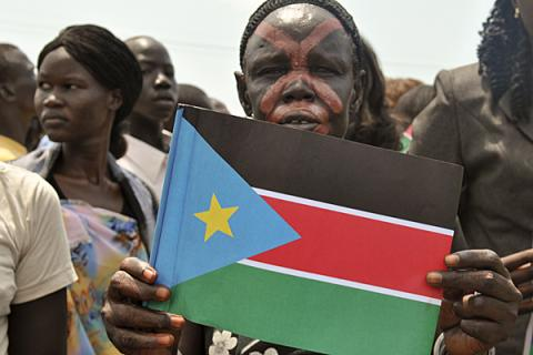 A woman with a painted face displays South Sudan's flag in celebration of South Sudan's independence in July 2011. (Photo: Joyce Mulama/World Vision)