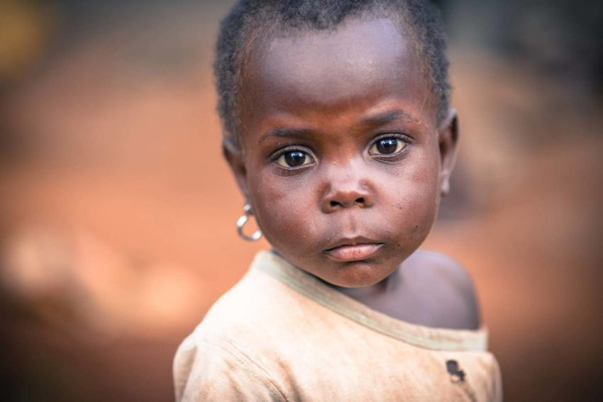 In Uganda, child sacrifice is a real danger. 3-year-old Sharon's pierced ears may protect her, and an amber alert helps recover kids that have been taken.