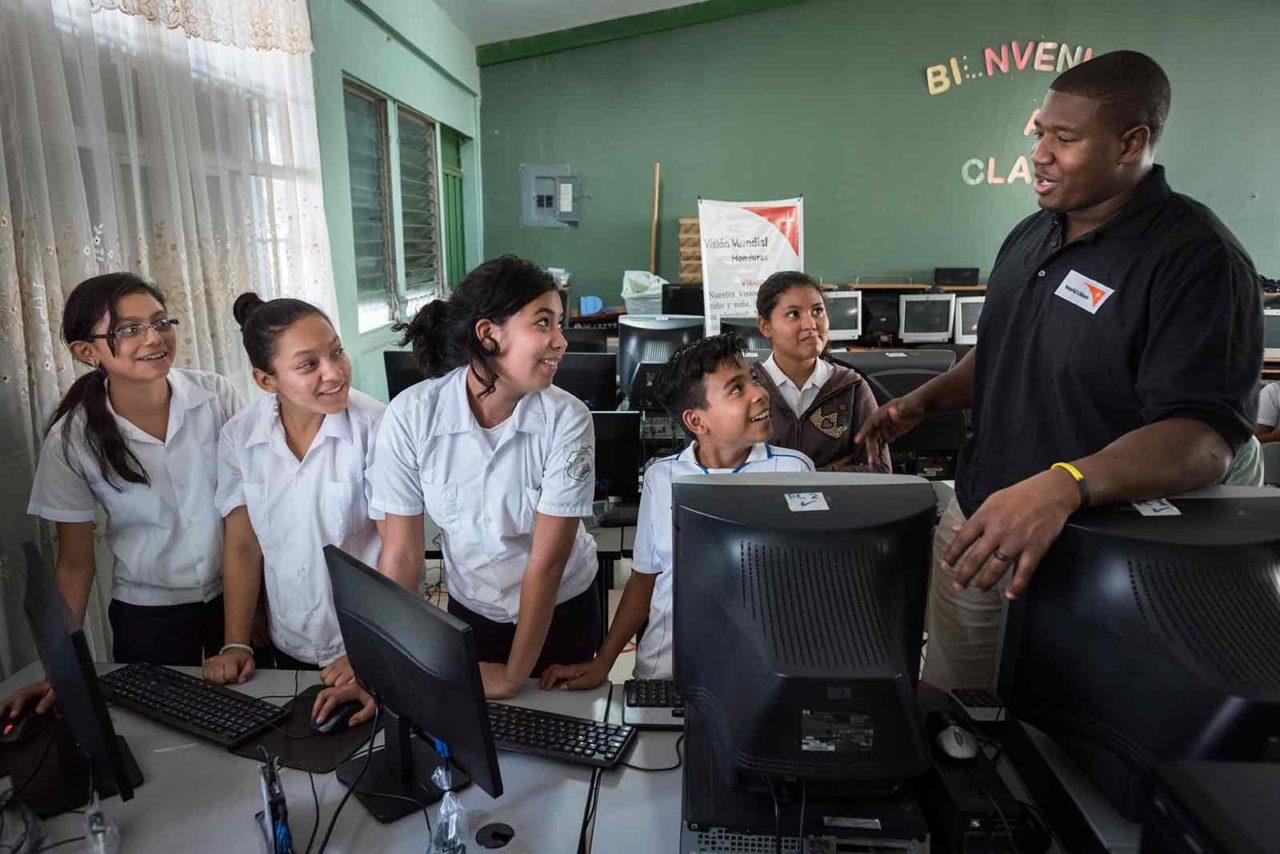 NFL player Kelvin Beachum Jr. interacts with children in Honduras.