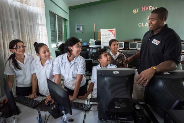 NFL player Kelvin Beachum Jr. interacts with children in Honduras.