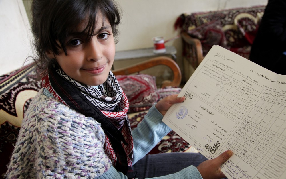 "Eight-year-old Jouri still has her report card from when she attended school in Syria — before she and her family had to flee because bombs dropped close to their home. Now they live as refugees in Lebanon. Jouri loves school and will do whatever it takes to continue her education. ""When we first came to Lebanon, I started nagging over and over on my dad to register me in school, but he kept on telling me there is no place for me,"" she says. World Vision launched education programs for Syrian refugee children to help them catch up what they've missed from being out of school and prepare them to attend formal schools when it's possible. Jouri says, ""Coming here [to World Vision's educational project] is the best thing that happened to me since we [left Syria]."""