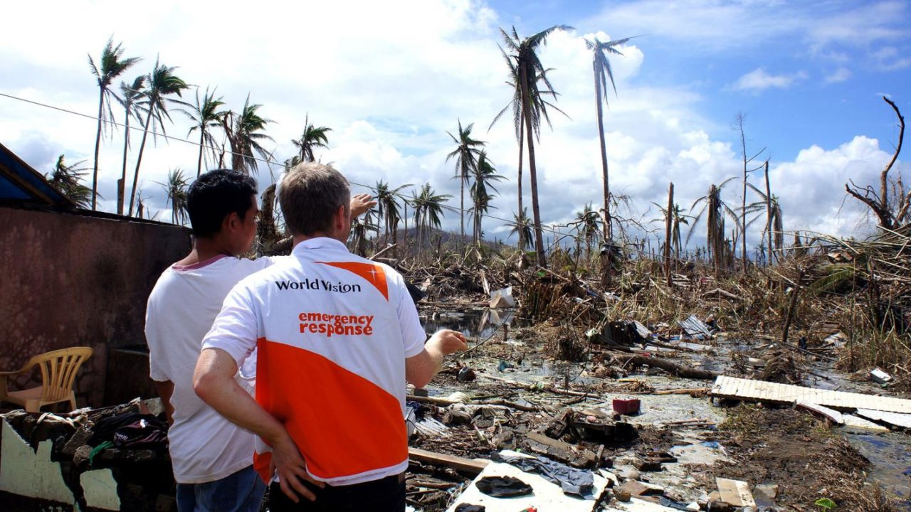 Typhoon Haiyan in the Philippines, 2013. Local resident and World Vision staff survey damage