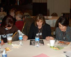 Participants pray together at the 2010 Women of Vision national conference.