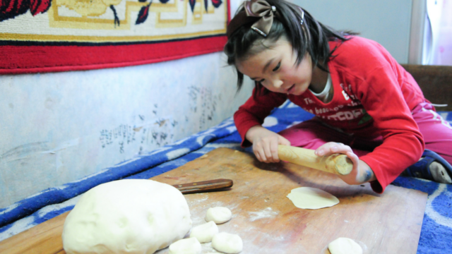 Mongolian cuisine is focused on meat and dairy, especially for nomadic herders. See what it's like to cook in this harsh climate, and try a recipe for buuz.