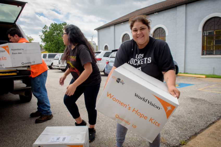 Parishioners and volunteers at Faith Memorial Baptist Church work alongsideWorld Vision U. S. Programs staff in a prayer before they unload relief supplies, which will be shared with people affected by Hurricane Harvey. (©2017 World Vision/photo by Laura Reinhardt)