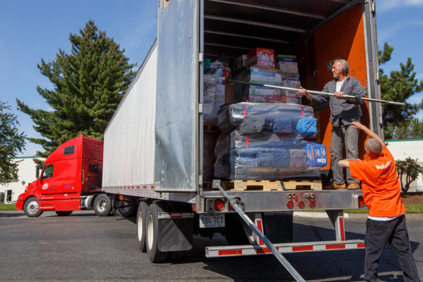 Larry Tall, a World Vision warehouse specialist, helps a truck driver secure emergency relief supplies for shipment from World Vision's Pacific Northwest field site to its site in Grand Prairie, Texas. The supplies will be distributed to victims of Hurricane Harvey. (©2017 World Vision/photo by Chris Huber)