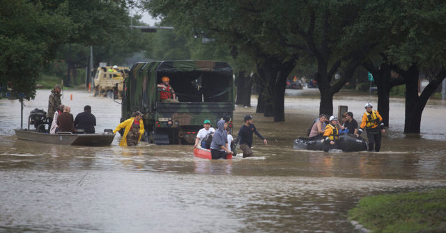 Rescue workers evacuate people in the residential areas of Texas from floodwaters during the aftermath of Hurricane Harvey on August 29, 2017.