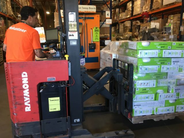 World Vision loads relief supplies from its warehouse in Fife, WA to send to hurricane-affected families in Texas.