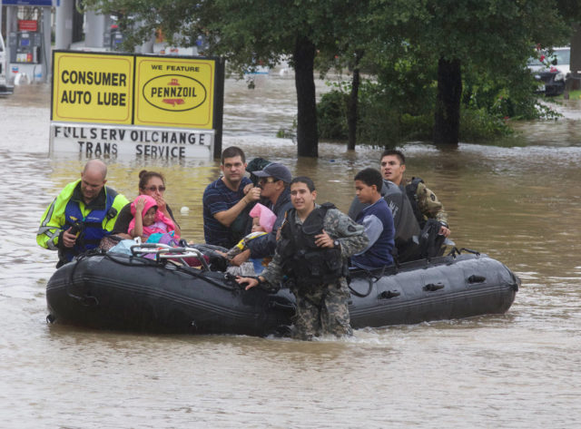 Rescue workers evacuate people from floodwaters during the aftermath of Hurricane Harvey on Tuesday, Aug. 29, 2017. (©2017 Genesis Photos/photo by Bradley J. Hodges)