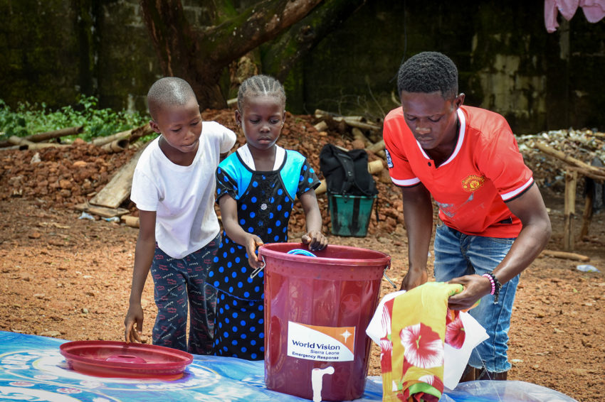 "Freetown: In a matter of minutes, 11-year-old Santigie and his 9-year-old sister, Samma, lost their family forever. When torrential rains caused a mudslide and flash floods that wiped out part of Freetown on Monday, Aug. 14, their father, mother, and two older siblings were swept away. Santigie and Samma only survived because their father carried them to safety before returning to the house for their birth certificates. It was then that they watched the water carry him away. ""Our mum was first to go missing in the waters. We were crying but we had hope and courage our dad was alive [but then] the water became very rough,'' shares a teary-eyed Santigie. (©2017 World Vision/photo by Sahr Ngaujah)"