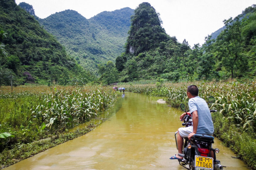 Guanxi province: A flooded road blocked transportation in rural Guanxi. The flooding in southern China began in late June, but the country has continued to be hit by heavy rains and tropical storms, triggering floods — the worst in 20 years in some areas. More than 11 million people have been affected. World Vision has distributed food, hygiene kits, bedding, and children's activity packs in China. (©2017 World Vision/photo by Wei Ming Hui)