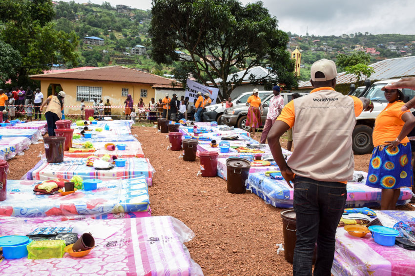 Children affected by the flashflood in Freetown lost not only family and personal property but educational materials. With schools opening in September, World Vision wanted to make sure children are able to attend. At a World Vision distribution, children receive school bags, books, pens, and pencils, along with mattresses, blankets, and hygiene kits. World Vision's response to this crisis extends to areas of health, water, sanitation, hygiene, and child protection. (© World Vision)