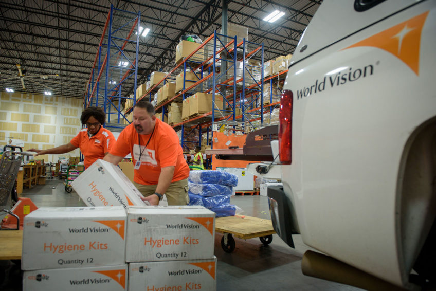 World Vision's Mike Bassett, warehouse manager at the Hartford field site, and Abi Flores, warehouse specialist at the North Texas field site, load personal care items and household and cleaning supplies onto a truck bound for Houston to help people affected by Hurricane Harvey. (©2017 World Vision/photo by Laura Reinhardt)