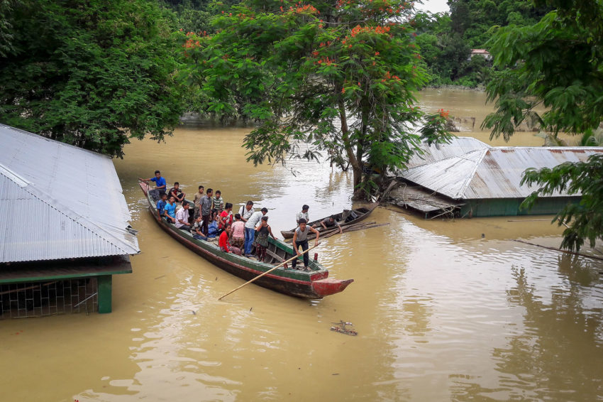 Mizoram State: Hundreds of villages were inundated in late June by monsoon rains that caused floods and mudslides. Here, residents of Mizoram are rescued in boats by emergency workers. World Vision has provided food, household items, hygiene kits, and shelter materials. (©2017 World Vision/photo by World Vision staff)