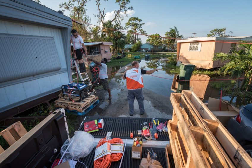 With help from members of Bethel Assemblies of God Church, Rich Moseanko, a member of World Vision's global rapid response team, delivers and installs a generator to bring power to five families in Immokalee, Florida. (©2017 World Vision/photo by Eugene Lee)