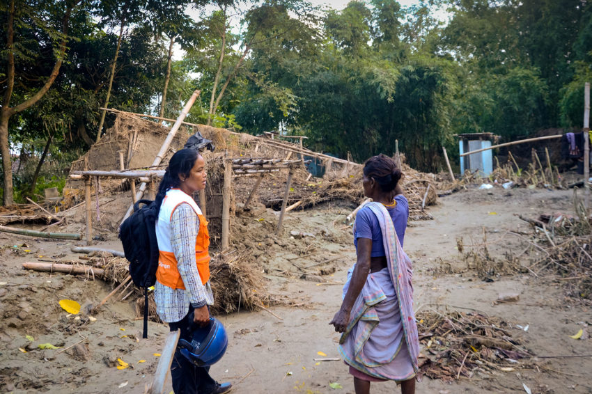 "When World Vision staffer Nissi Thapa visited villages in Morang, Nepal, a month ago, she met ""cheerful faces, showing [her] their thatched mud-mortar huts."" When she returned to assess the damage of massive flooding, she found desolation instead. Homes were swept away — the remnants mangled and buried in the sand. ""The water came in like a tsunami,"" recalls Savitri (right); ""I am amazed that I made it out alive."" She now lives in a makeshift shelter with her family of eight. (©2017 World Vision)"