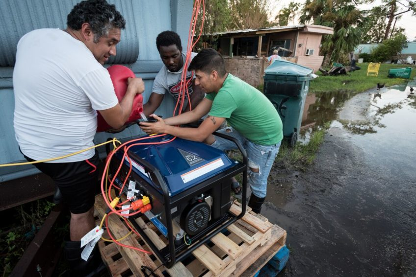 Cristian Alemán, 29, worship leader at Bethel Church, pours gas into the generator. One generator can provide power for 10 to 12 hours. Rich later brought a second generator so families can have power 24 hours a day by switching between two. (©2017 World Vision/photo by Eugene Lee)