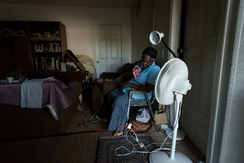 """""""I have two fans and one light working,"""" says Mackenro's grandmother Venita Francois, 68. She looks forward to being able to cook and to restocking her refrigerator after she cleans out the spoiled food. (©2017 World Vision/photo by Eugene Lee)"""