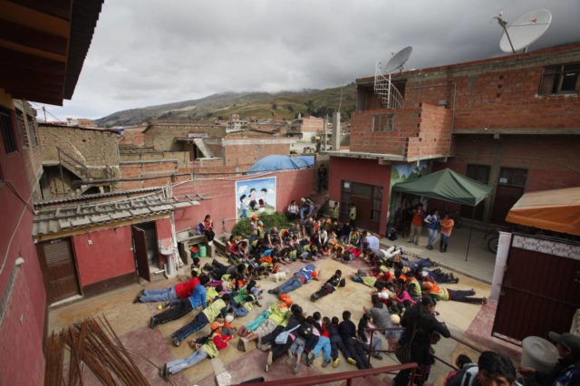 Children in Colomi, Bolivia, gather for more than just fun and games in a World Vision program designed to help them overcome poverty, malnutrition and a stark future. (©2014 World Vision/photo by Gary Fong/Genesis Photos)