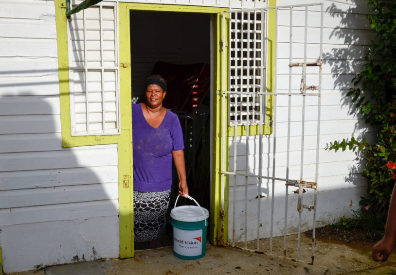 A woman receives relief supplies in the Dominican Republic after Hurricane Maria flooded much of her community. (©2017 World Vision/photo by Juan Pablo Ramirez Gan)
