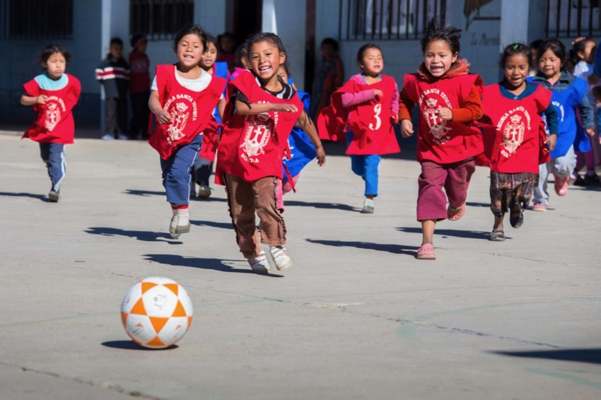 All around the world, boys and girls play the world's most popular sport — the game we in the U.S. call soccer and the rest of the world calls football. We break down five benefits of soccer for kids.