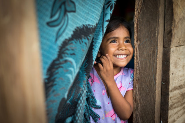 World Vision photographer Eugene Lee captures the smiles of a Nicaraguan girl who proves that with the right help, malnourished children can get their health back.