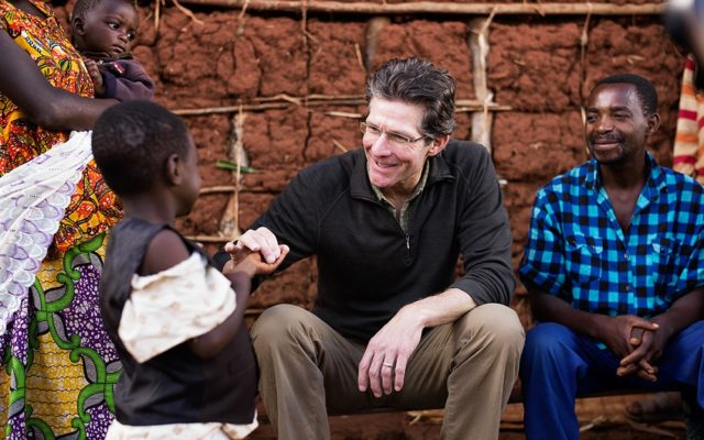 Dr. Paul Osteen meets Alice, a World Vision sponsored child, and her family in Butare, Rwanda.