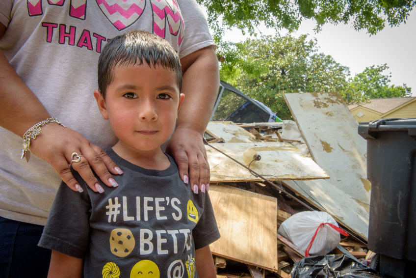 "After Hurricane Harvey flooded their home, Crystal brought 5-year-old Vincent back so he could understand why they weren't staying there anymore. He asked, ""Who put my toys on the floor?"" when he saw his playroom with toys knocked off the shelf. (©2017 World Vision/photo by Laura Reinhardt)"