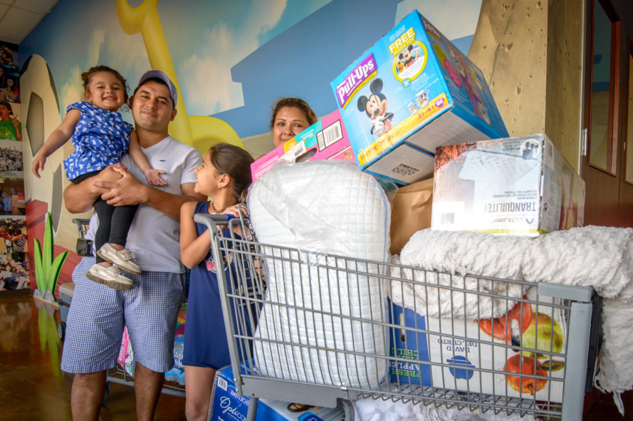 Milton and Linet Orellana and their two daughters, 10-year-old Valerie, and 3-year-old Natalie came to a distribution of relief supplies at Parkway Fellowship Church in Katy, Texas, in the aftermath of Hurricane Harvey. (©2017 World Vision/photo by Laura Reinhardt)